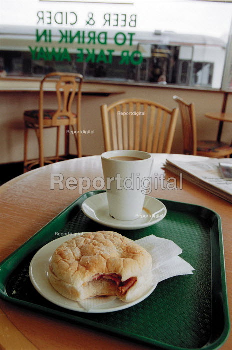 Breakfast bacon bap and cup of coffee in a railway station buffet. - John Harris - 2001-05-19