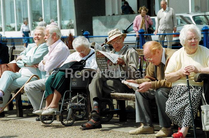 Elderly sitting on the seafront, Eastbourne. - John Harris - 2001-06-14