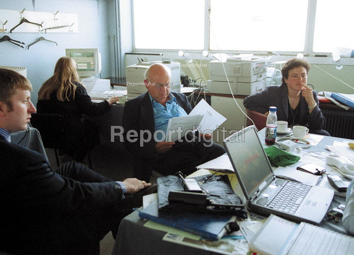 Roger Lyons MSF with staff in a temporary office at ADM conference. - John Harris - 2001-06-14