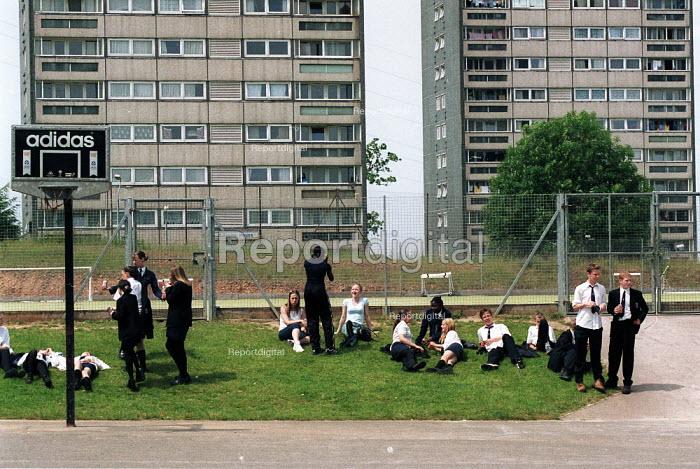 Pupils in the playground with tower blocks at Baverstock secondary School Birmingham - John Harris - 2001-06-25