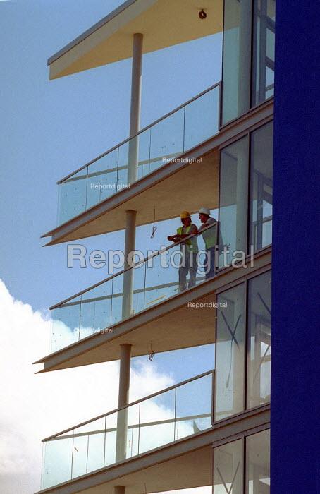Construction workers take a break. New flats Bristol. - John Harris - 2001-08-30