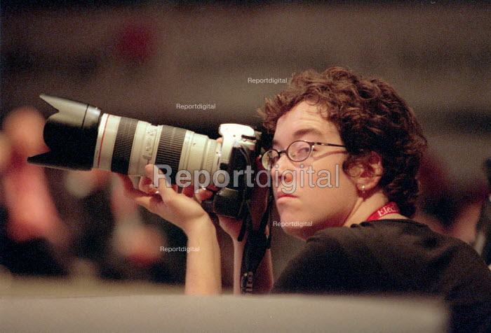 Press photographer taking photographs. Labour Party Conference 2001 - John Harris - 2001-10-01