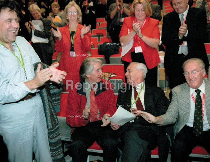 Standing ovation for Tony Benn MP after his speech against the war. Dennis Skinner MP congratulating. Labour Party Conference 2001 - John Harris - 2001-10-02