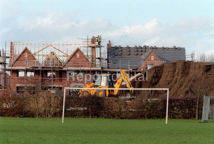 New houses being built on School playing fields. The School has sold off the land to pay for the construction of new school buildings. - John Harris - 2002-03-07