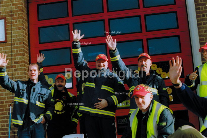 Waving to supporters, Firefighters strike. Stratford on Avon Fire station. - John Harris - 2002-11-15