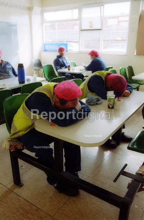 Exhausted workers catch a few minutes sleep during their break, canteen. British Bakeries, Birmingham - John Harris - 2002-08-27