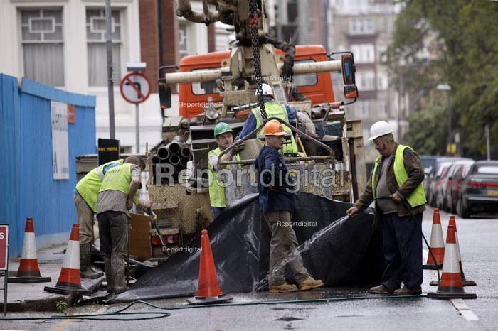 Workers repairing the road, London - John Harris - 2003-06-06