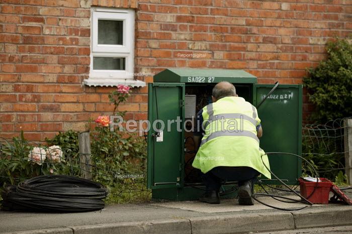 NTL Telecoms engineer repairing a junction box in the street. - John Harris - 2003-06-05