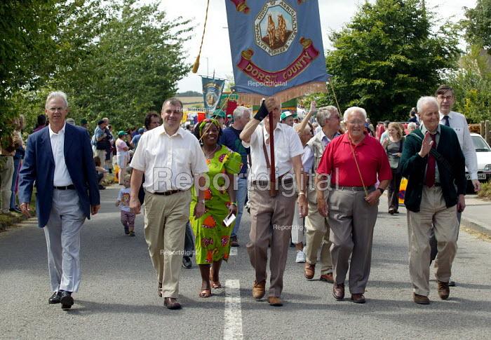 Nigel de Gruchy TUC President, Brendan Barber TUC and Gertrude Hambira GAPWU of Zimbabwe Gen Sec, Gen Sec Tolpuddle Martyrs Festival Dorset. - John Harris - 2003-07-20