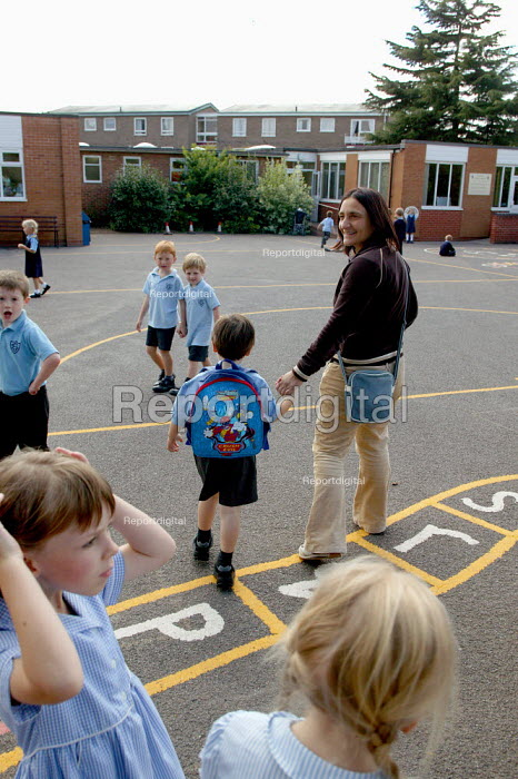 Schoolboy about to entering the playground on his first day at school. - John Harris - 2003-09-02