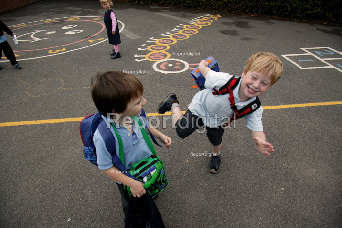 Pupils in the playground as they are collected by parents from School. - John Harris - 2003-10-03
