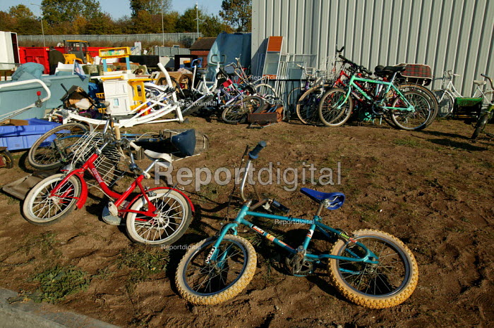 Children's bicycles at a recycling centre at a rubbish tip. Warwickshire. - John Harris - 2003-10-23