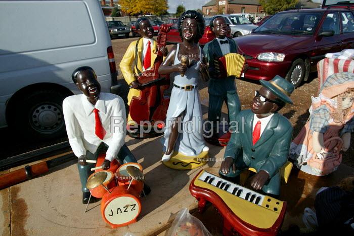 Figures of black musicians on a stall. Car boot market, Warwickshire. - John Harris - 2003-11-01