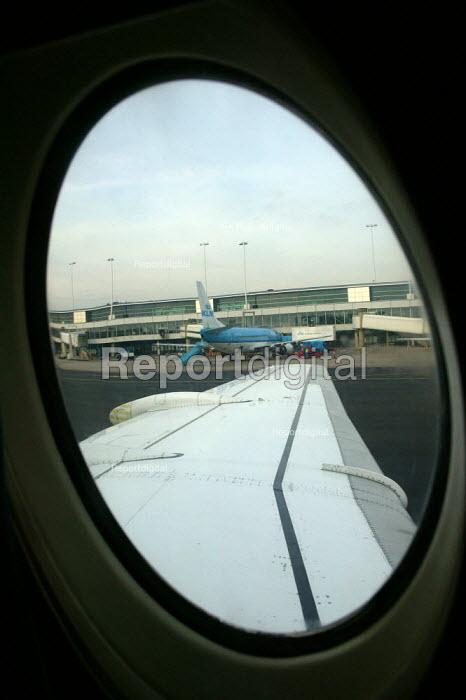 Amsterdam airport from a passengers window. - John Harris - 2003-11-25