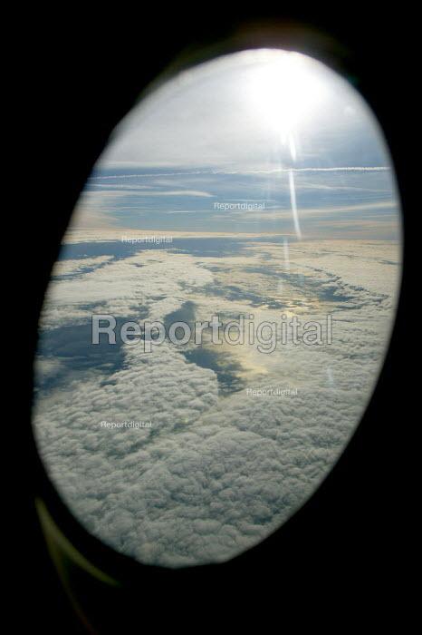 Sky sun and clouds from a passengers window. - John Harris - 2003-11-25
