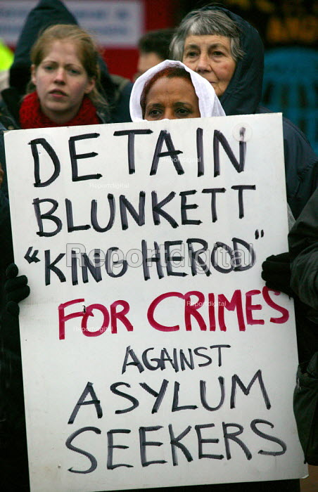 Asylum seekers holding placards protesting Blunkett King Herod for jailing children and crimes against asylum seekers. Campaign to close Campsfield. Protest marking the 10th anniversary of the Campsfield Detention Centre in Oxfordshire used to imprison asylum seekers. - John Harris - 2003-11-29