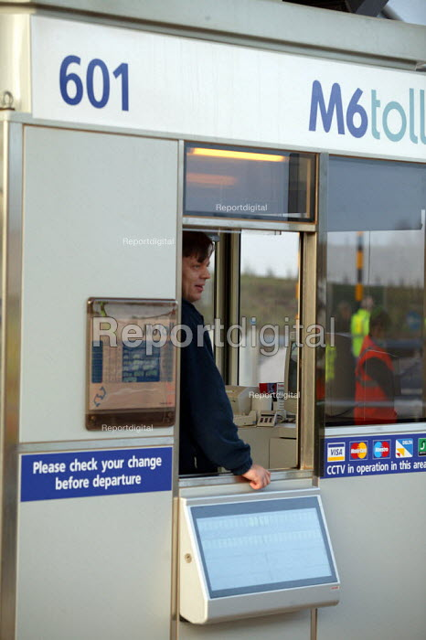 Worker in a Toll Booth. M6 Toll Road is the first tolled motorway in Britain, and is intended to reduce the congestion on the M6. Birmingham Northen Relief Road Weeford Toll booths, West Midlands. - John Harris - 2003-12-09