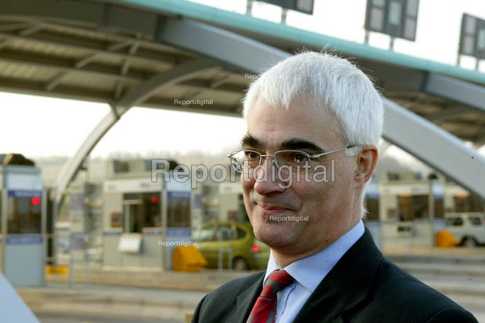 Sec of State for Transport Alistair Darling MP at the opening of the M6 Toll Road. The M6 toll is the first tolled motorway in Britain, and is intended to reduce the congestion on the M6. Birmingham Northen Relief Road Weeford Toll booths, West Midlands. - John Harris - 2003-12-09