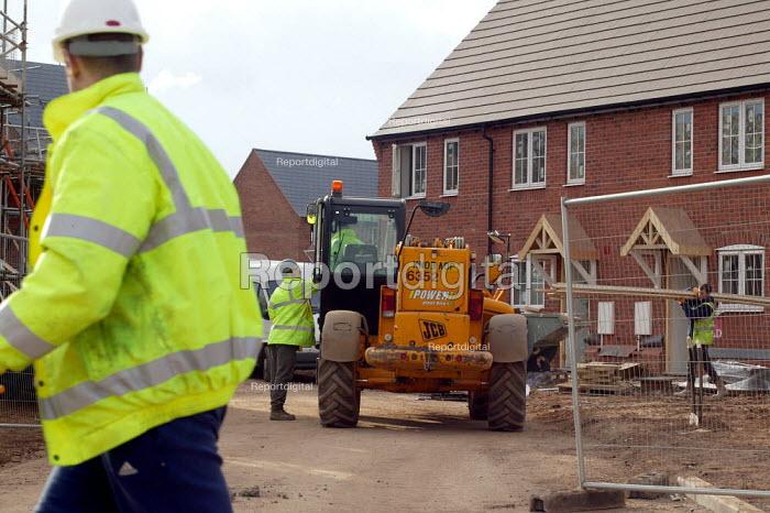 Construction of houses on a high density new estate on the edge of town. Stratford on Avon. - John Harris - 2004-02-26