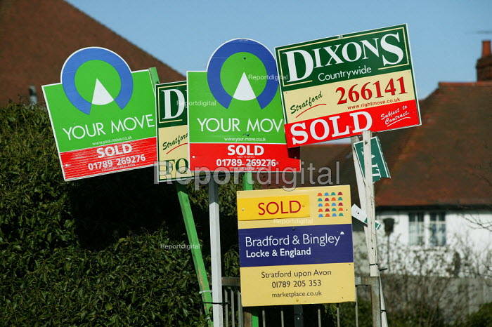 Estate agents For Sale signs, sold flats. - John Harris - 2004-03-13