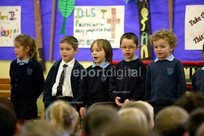 Pupils singing at morning assembly at a catholic junior school. - John Harris - 2004-03-19