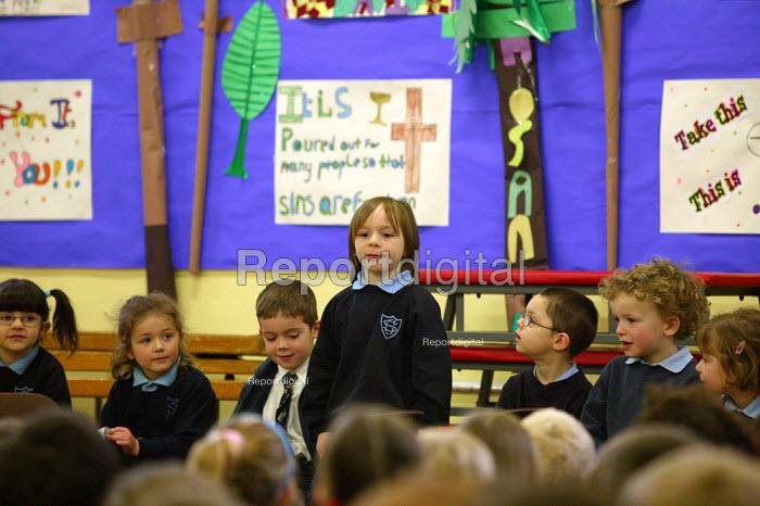 Pupil speaking at morning assembly at a catholic junior school. - John Harris - 2004-03-19