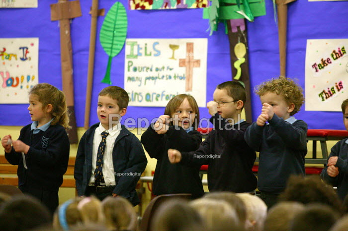 Pupils singing at morning assembly at a catholic junior school. - John Harris - 2004-03-19