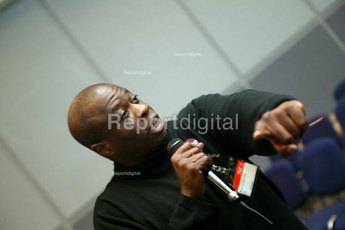 Activist speaking at TUC Unite against fascism rally NEC. - John Harris - 2004-04-03