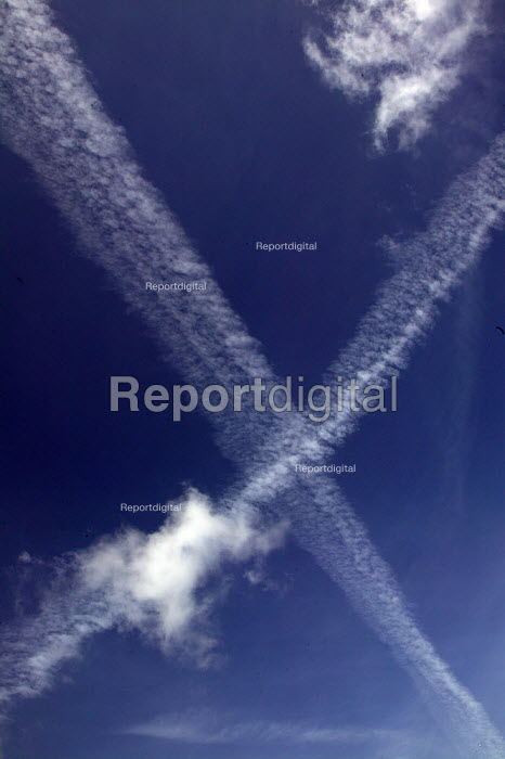 Vapor trails from jet aircraft in the blue sky. - John Harris - 2004-05-07