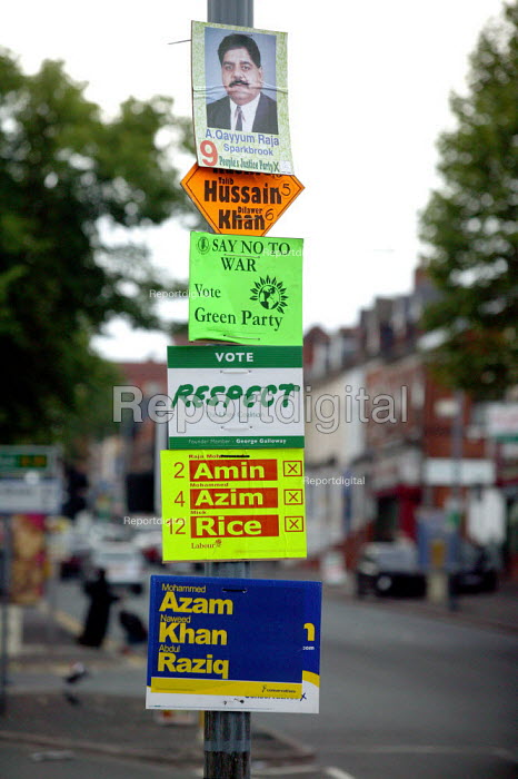 Local council election posters, showing Muslim candidate for the People's Justice Party, Liberal Democrats, Green Party, Respect, Labour Party and Conservatives candidates, Sparkbrook ward, Birmingham. - John Harris - 2004-06-09