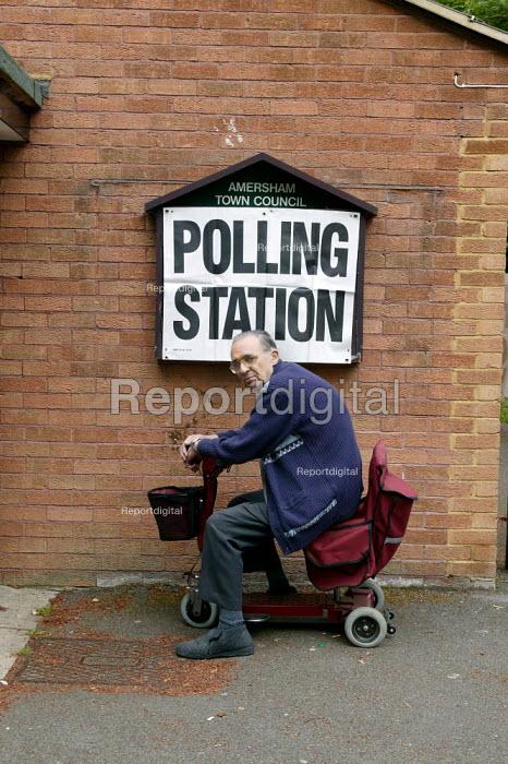 Disabled elderly man arriving at the polls to vote. Amersham, Buckinghamshire - John Harris - 2004-06-10