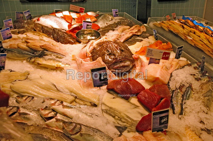 Fillets of fish on display at the fishmongers counter, Safeways Supermarket. - John Harris - 2004-06-26