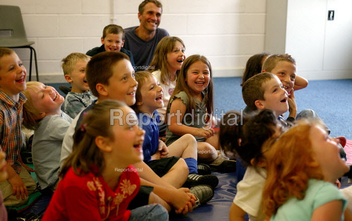Laughter at party entertainer, 5th birthday party. - John Harris - 2004-06-20