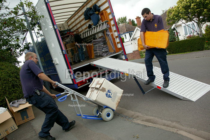 Removal men unloading a pantechnicon. - John Harris - 2004-07-02