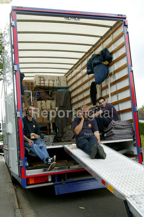 Removal men unloading a pantechnicon. Taking a break. - John Harris - 2004-07-02