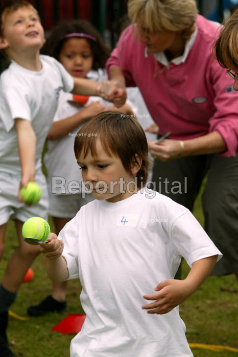 Emilio competing in a egg and spoon race at School Sports Day. - John Harris - 2004-07-13