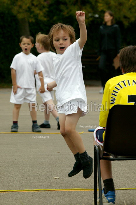 Emilio competing in a relay race at School Sports Day. - John Harris - 2004-07-13