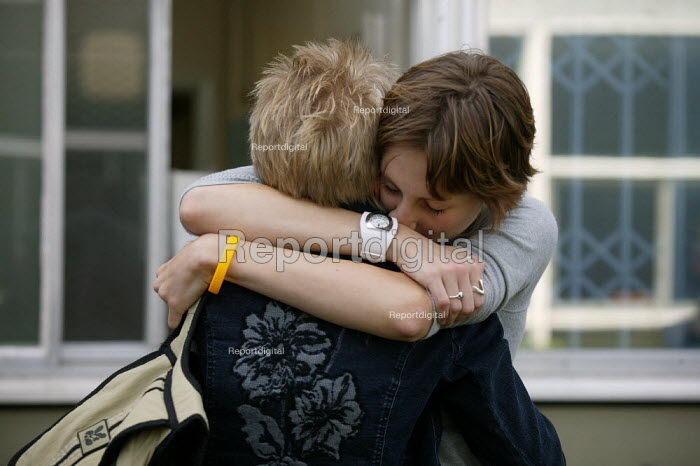 Student hugging her mother who also passed. A level results, Stratford upon Avon College. - John Harris - 2004-08-19