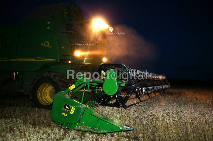 Combine harvester working at night to reap the harvest. Warwickshire. - John Harris - 2004-08-31