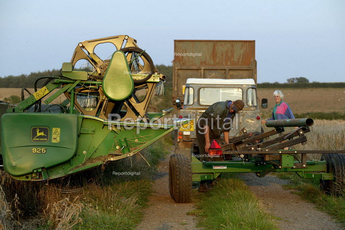 Moving the combine harvester to reap the harvest. Warwickshire. - John Harris - 2004-09-02
