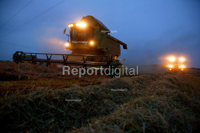 Combine harvester working at night to reap the harvest. Warwickshire. - John Harris - 2004-09-02