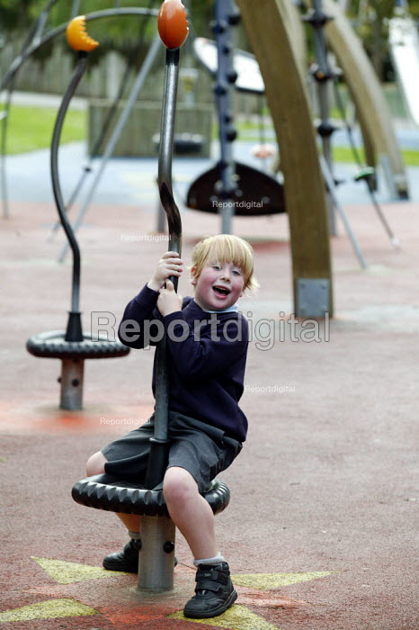 Schoolboys playing at a council recreation children's playground after school. Stratford on Avon. - John Harris - 2004-09-22