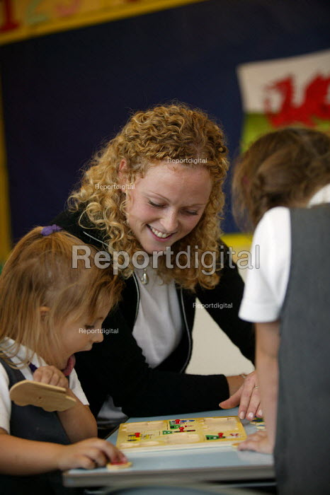 Rhian Samuel newly qualified teacher at YSGOL SANT CURIG Primary School, a Welsh language speaking school, Barry, South Wales - John Harris - 2004-09-23