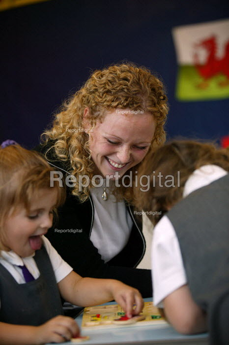 Rhian Samuel newly qualified teacher at YSGOL SANT CURIG Primary School, a Welsh language speaking school, Barry, South Wales - John Harris - 2004-09-23