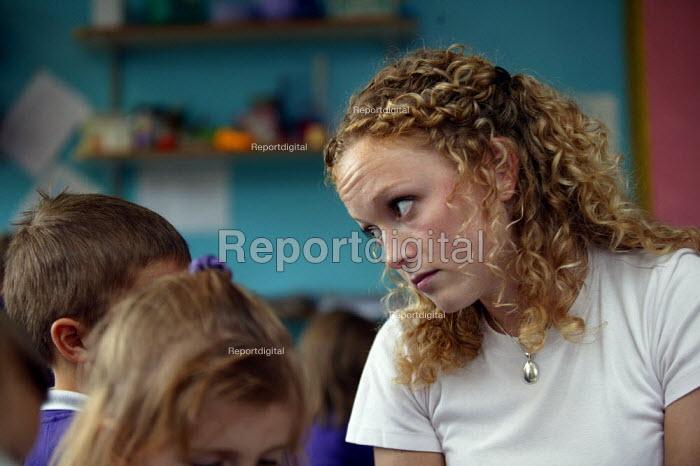 Rhian Samuel newly qualified teacher teaching reception infant class at YSGOL SANT CURIG Primary School, a Welsh language speaking school, Barry, South Wales - John Harris - 2004-09-23