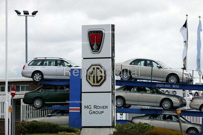 Cars leaving on a car transporter MG Rover Group Longbridge Birmingham as production is halted. - John Harris - 2005-04-07