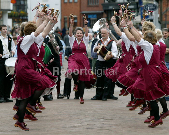 Morris dancers performing in the street. Stratford upon Avon town centre. - John Harris - 2005-04-17