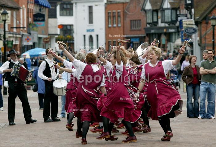 Morris dancers performing in the street. Stratford upon Avon town centre. - John Harris - 2005-04-17
