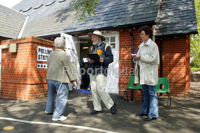 Supporters as polling station tellers. Tellers outside the polling station try and obtain the details of electors who have voted. polling station in the general election. Stratford upon Avon - John Harris - 2005-05-05