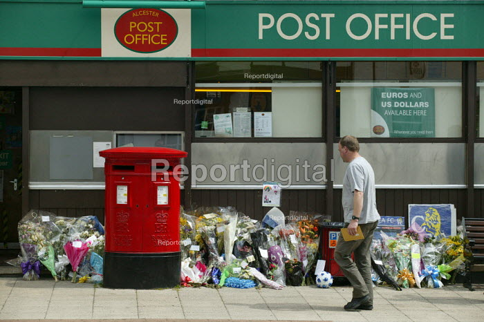 Floral tributes to a Warwickshire postman outside the Alcester Post Office. He was killed in a road traffic accident whilst cycling to work. - John Harris - 2005-05-17